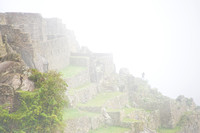 Machu Picchu - Man Shrouded in Mist and Clouds